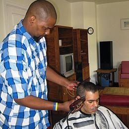 Using barbering tools he bought with funds from The SERV Foundation, Wayne gives a haircut to fellow SERV consumer, Carlos, at SERV Centers' Serenity House in Mercer County.