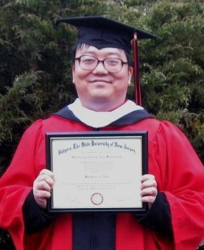 "Pang-Yen ""Ben"" H., a consumer with SERV Centers of New Jersey Central Region, holding his diploma for his bachelor's degree in English and Chinese language."