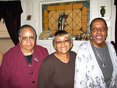 Pearl Hadley, center, a family care provider with SERV Centers of New Jersey-Hudson County, is flanked by two of the three SERV consumers who live in her home in Jersey City – Elsie, left, and Rosa.